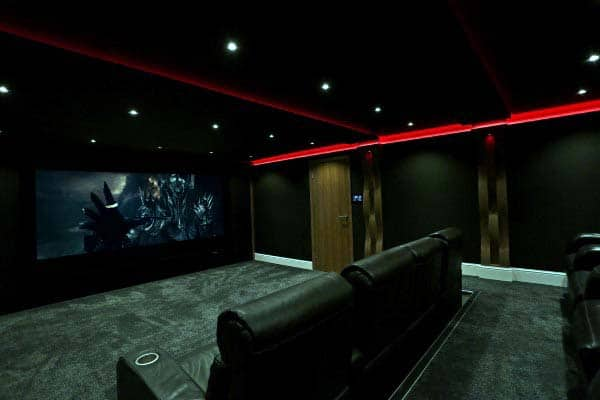 Dark Black Media Room With Red Neon Lighting