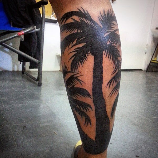 Dark Black Palm Tree Tattoo For Men On Lower Limb