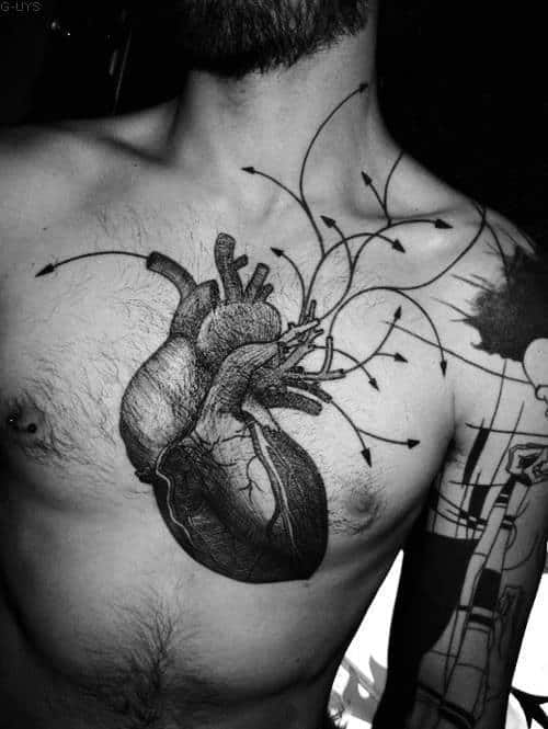 Dark Black Work Heart Tattoo On Mans Chest