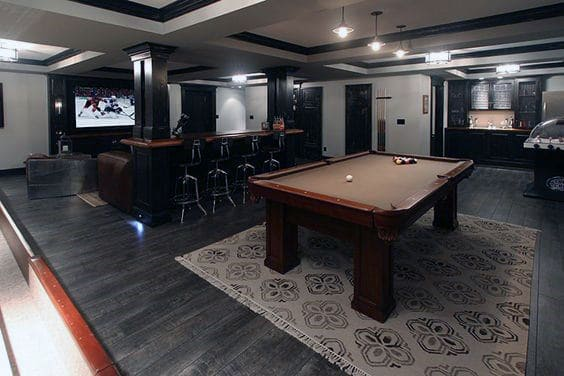 Dark Hardwood Flooring Basement Design With Pool Table And Movie Room