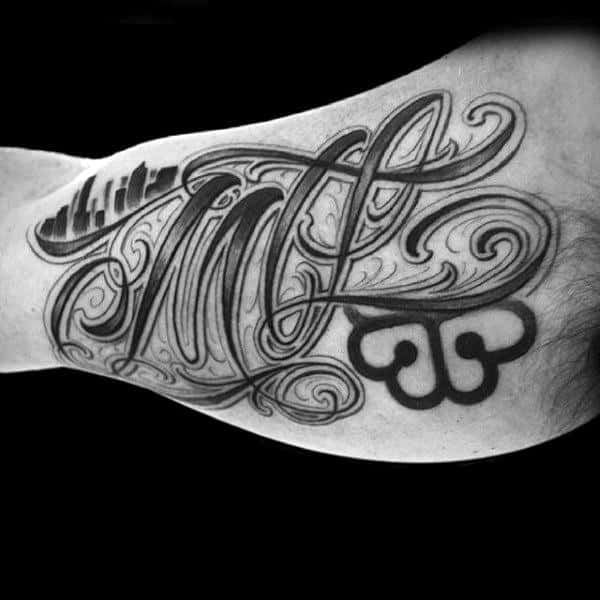 Dark Lettering Tattoo Male Inner Biceps