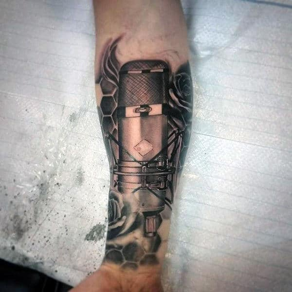 Dark Metallic Musical Tattoo For Men On Wrist