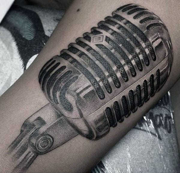 Dark Shaded Pencil Art Tattoo Of Microphone Guys Forearms