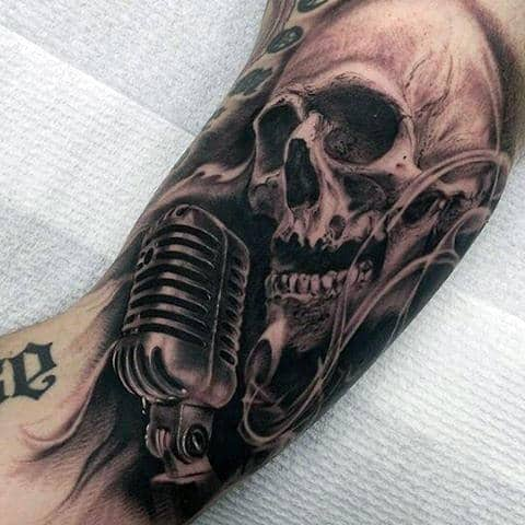 Dark Singing Skull Tattoo On Arms For Men
