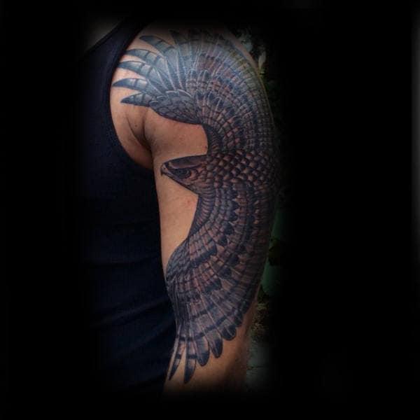 Dark Stylish Hawk Upper Arm Tattoo On Man