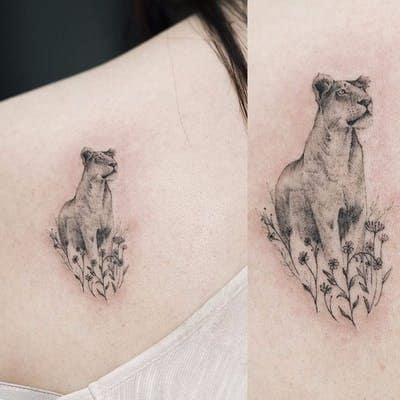 Delicate Small Lioness Tattoo