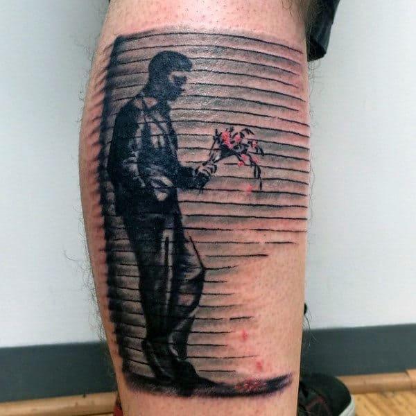 Depressed Man Holding Flowers Mens Banksy Leg Tattoos