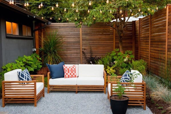 Design Ideas For Patio String Light Attached To Privacy Fence And House Roof