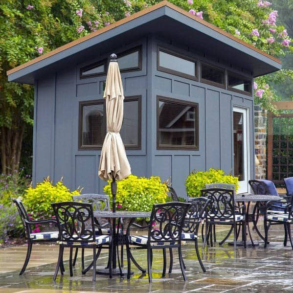 Designs For Blue Backyard Shed With Modern Windows