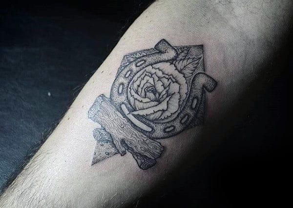 Detailed Dotwork Horseshoe Tattoo On Guys Inner Forearm