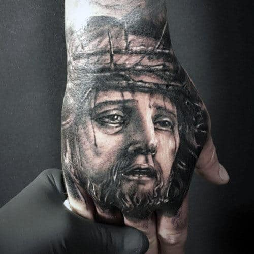 Detailed Guys Jesus Portrait Tattoo Ideas On Hands