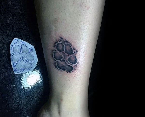 Detailed Male Fuzzy Dog Paw Print Tattoo On Lower Leg