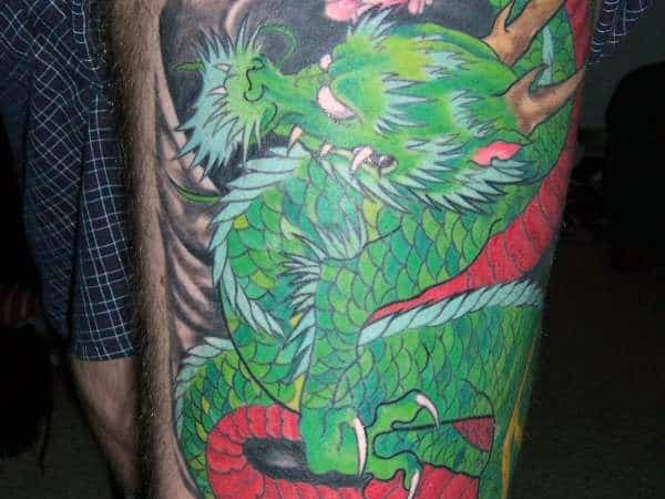 Detailed Mens Green Dragon Thigh Tattoo Japanese Style