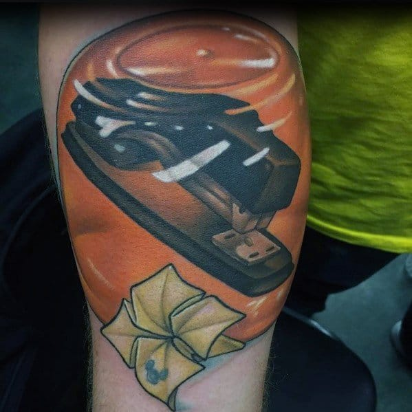 Detailed Mens The Office Stapler In Orange Jello Tattoo Design Ideas