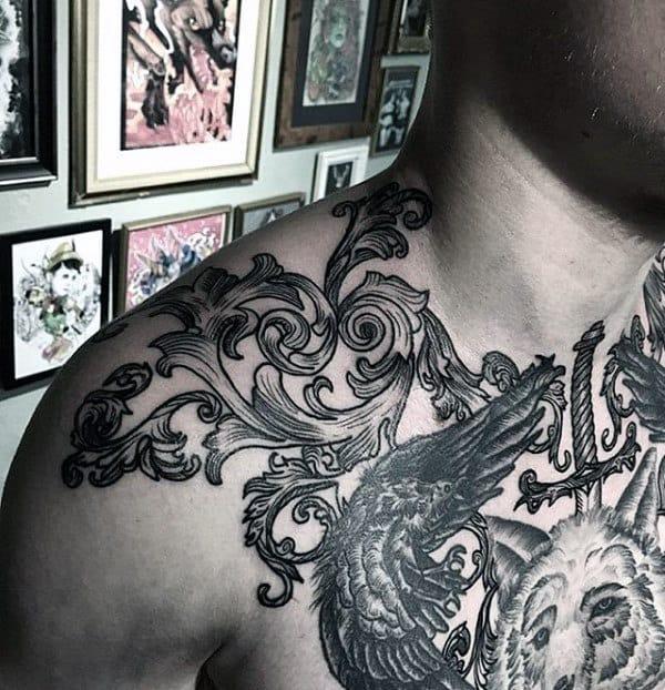 Detailed Woodcut Filigree Tattoo On Mans Shoulder