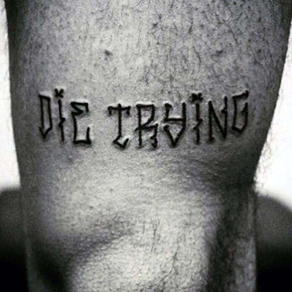 Die Trying Black Tattoo Male Thighs