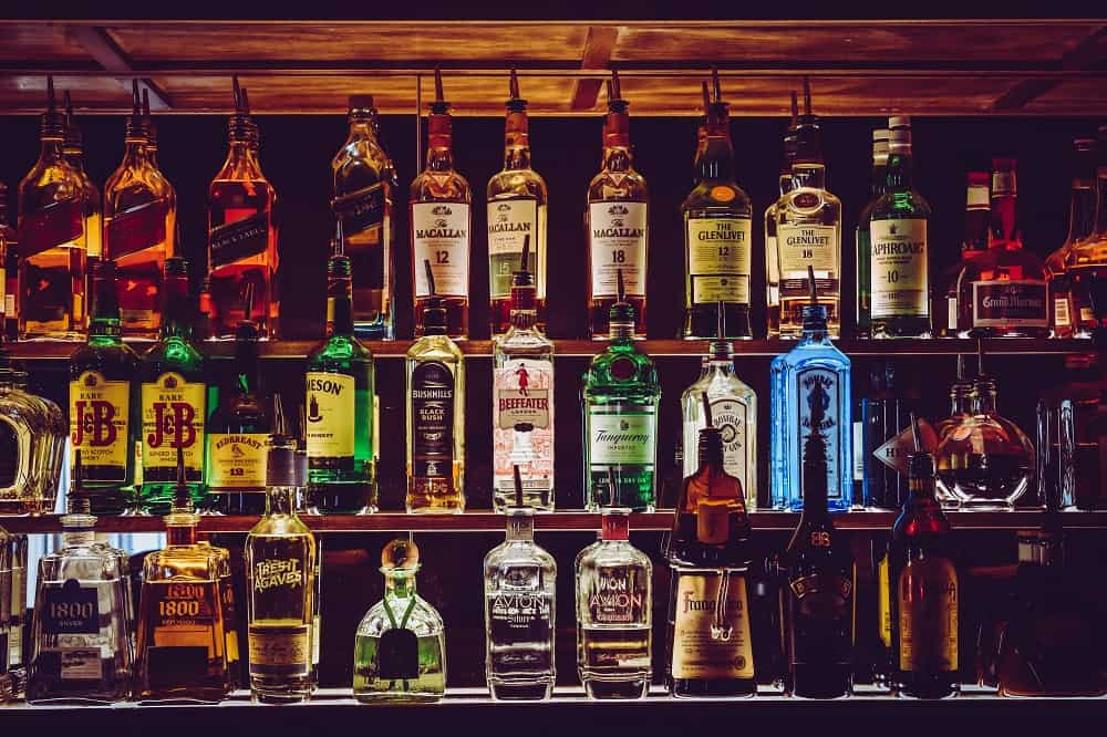 different types of whisky bottles in bar