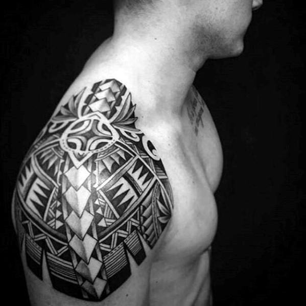 Distinctive Male Awesome Shoulder Tribal Tattoo Designs
