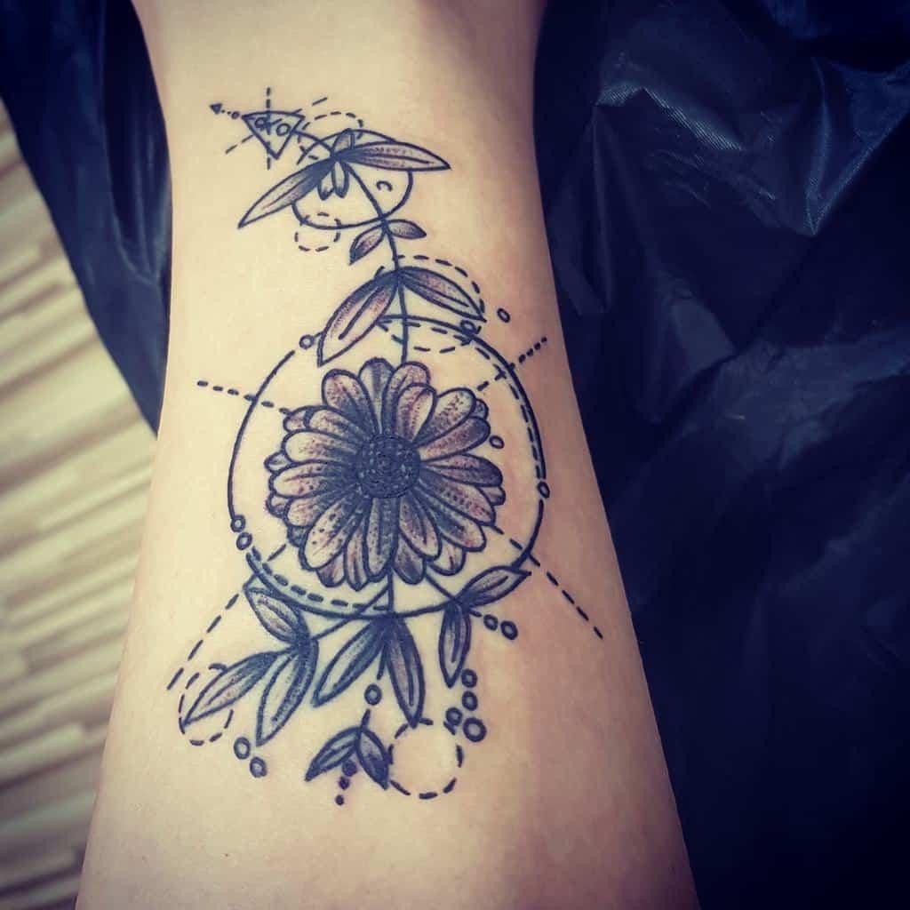 Calf tattoo black and grey bold lines dots dashes and circles daisy