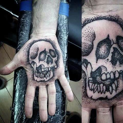 Dotted Grey Skull Tattoo On Male Palms