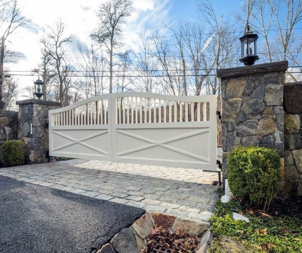 Double Gates Painted White For Driveway Entrance Of Home