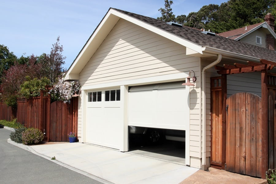 Dark Stained Wood Garage Door Ideas With White House Brick