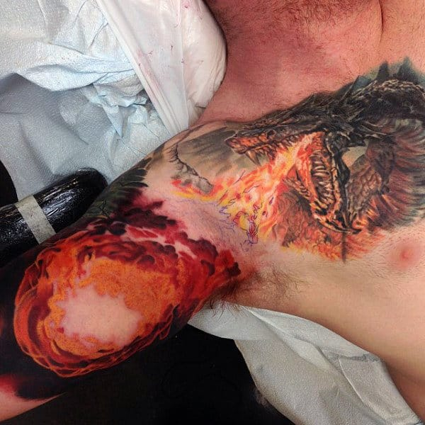 Dragon Breathing Fireball Mens Chest And Inner Arm Tattoos