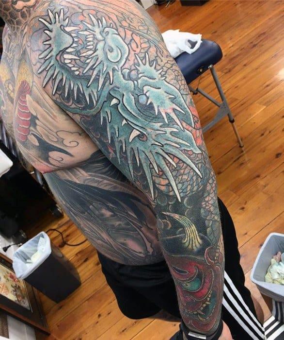 Dragon Guys Tattoos With Blast Over Design