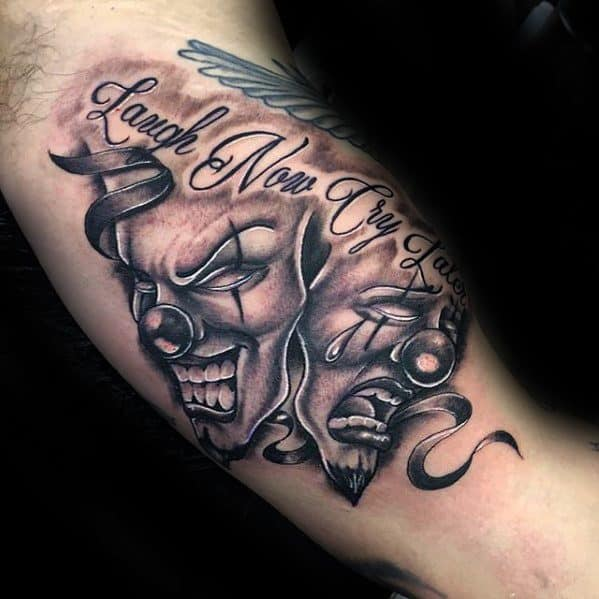 Drama Mask Tattoo Design On Man Laugh Now Cry Later Inner Arm