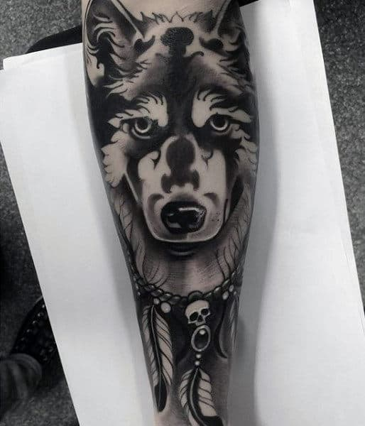 Dreamcatcher Tattoo Design On Mans Forearm With Wolf
