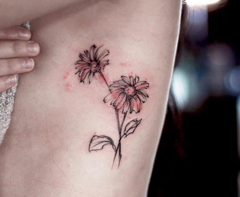 Rib tattoo black and grey dreamy sketch-like daisy