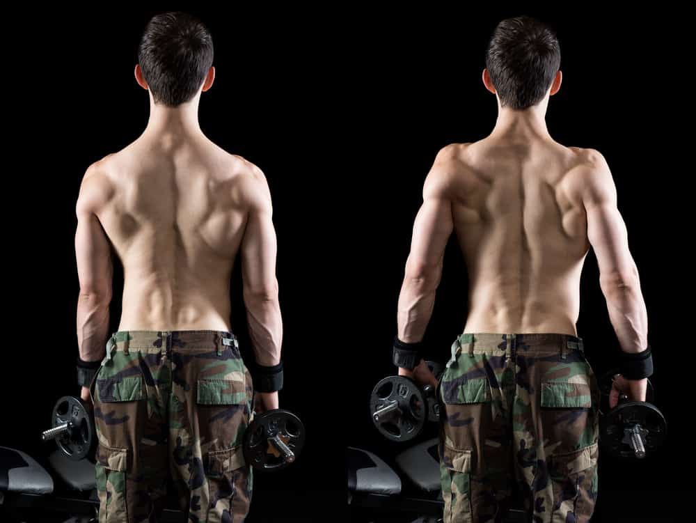 back of young man doing dumbbell shrug exercise, studio shot
