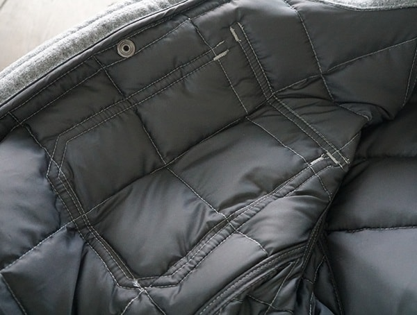 Durable Stiching Details On Interior Nau Utility Wool Down Jacket In Cape Heather