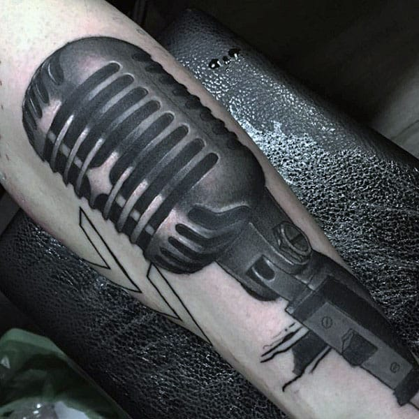Dusty Black Microphone Tattoo Guys Forearm