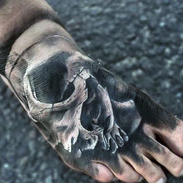Eerie Skull On Foot Tattoo For Guys