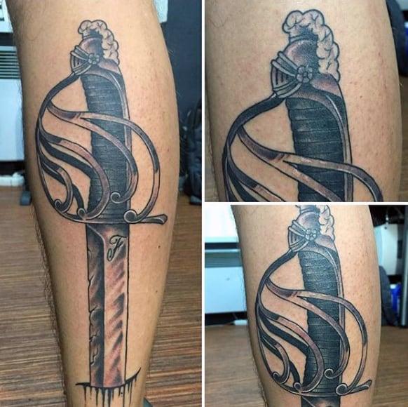 Elegant Guys Swords Tattoo On Leg