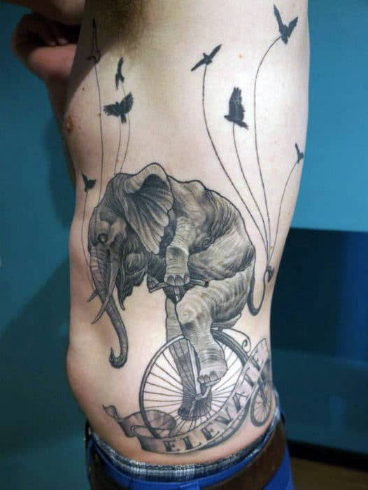 Elephant On Wheels In A Circus Tattoo Males Torso