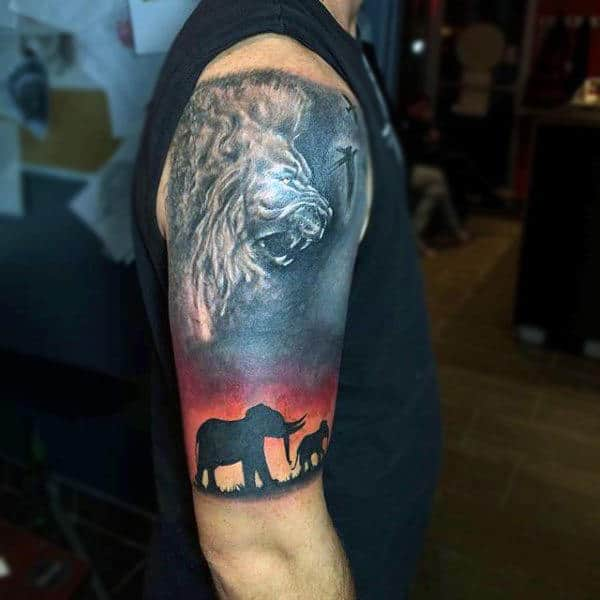 Elephants With Angry Lion Image On Sky Tattoo Guys Arms