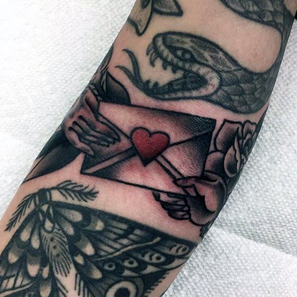 Envelope With Heart Ditch Tattoo Design On Man