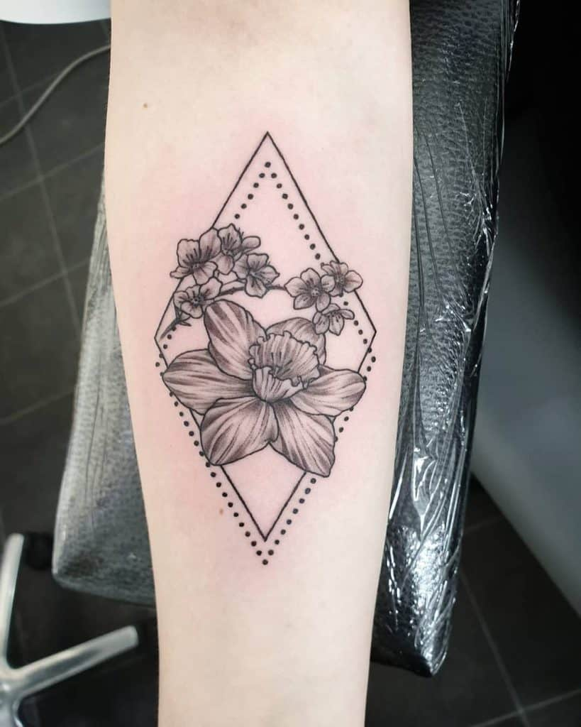 Epic Grayscale Daffodil Framed By Diamond Dotwork And Line Tattoo