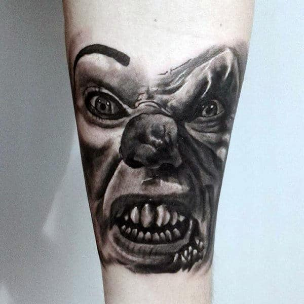 Evil Clown Shaded Black And Grey Ink Male Tattoo Designs On Inner Forearm