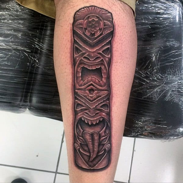Evil Face Totem Pole In Red Ink On Calf Tattoo On Gentleman