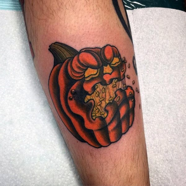 Evil Pumpkin With Seeds In Mouth Mens Leg Tattoo