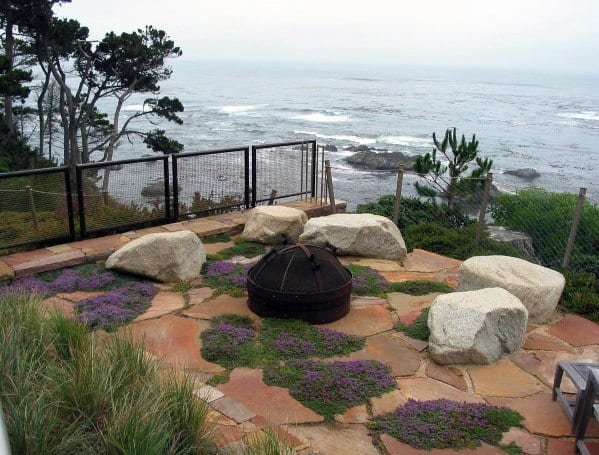 Excellent Backyard Ideas Flagstone Patio With Boulders And Fire Pit In Center
