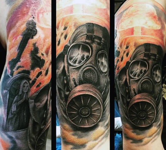 Explosion Fire Mens Gask Mask Tattoo On Upper Arm