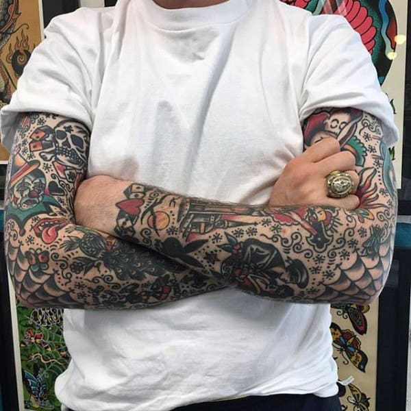 Extensive Dotted Work Traditional Tattoo Guys Forearms