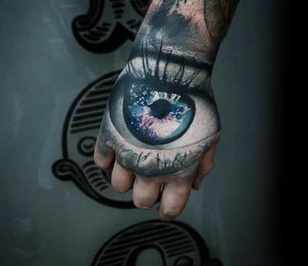 Eye With Outer Space Design Crazy Male Hand Tattoos