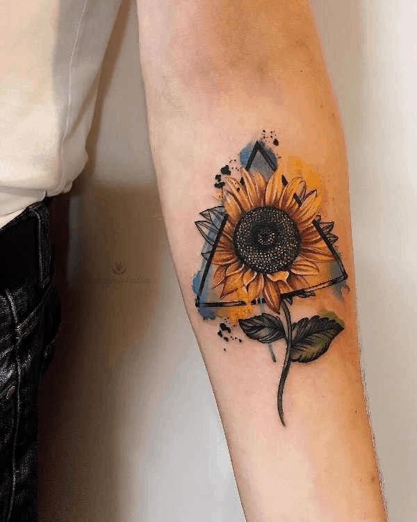 medium-sized color watercolor tattoo on man's forearm of a surrealistic sunflower inside a geometric triangle