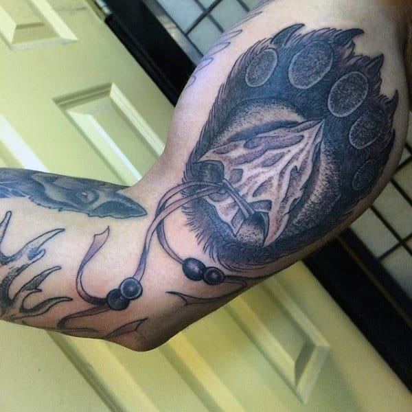 Fabulous Grey Arrowhead Tattoo On Arms For Men
