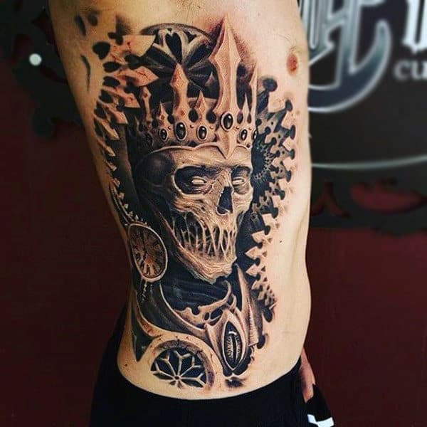 Fabulous Skull With Crown Tattoo Males Side Ribs